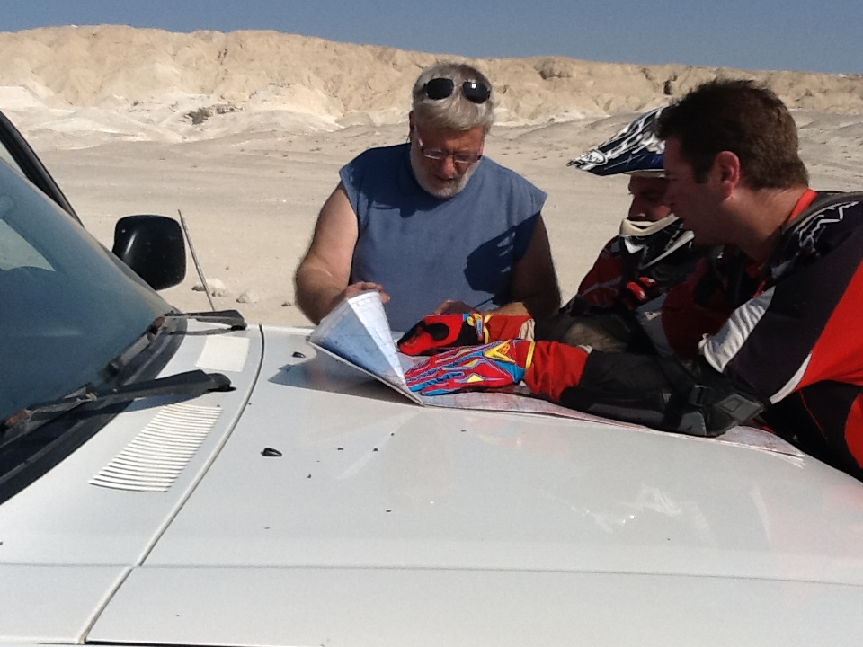 Ofer, Matan and Nimrod discussing the route to camp.