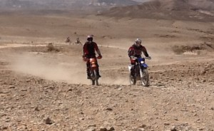 Bikes approaching the Dead Sea cliff from the Judean Desert.