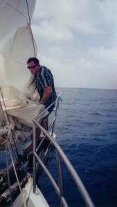 Kim reefing in sail.