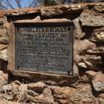 Wall and plaque erected by the Eastern Goldfields Historical Society in 1950.