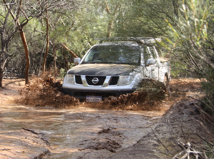 Tony takes his Navara through the water.