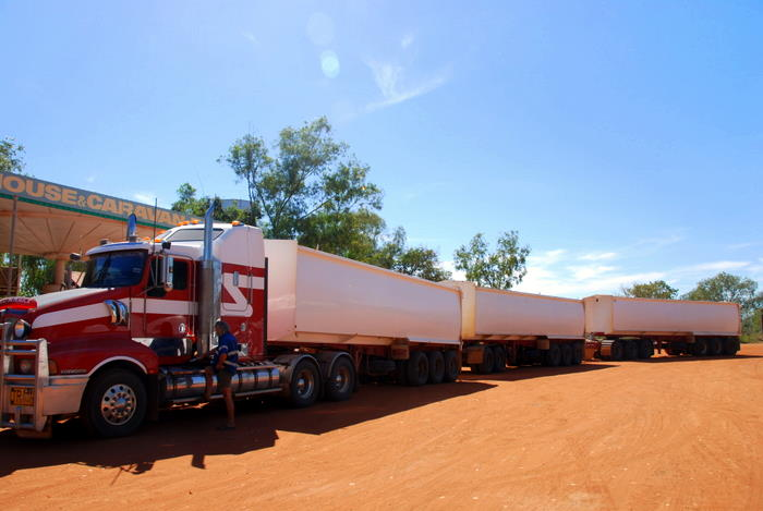 Triple road train - 16 foot longer than the width of a US football field. Carries up to 220 tonnes at 100 kph. 62 wheels (2 steer, 8 drive and 52 trailer). Operate only in the Australian Outback.