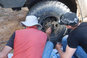 Greg and Dan working on the wheel bearing.