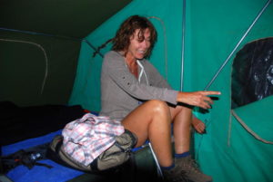 Tammy laughing at Kim's effort to remove a frog from the camper.