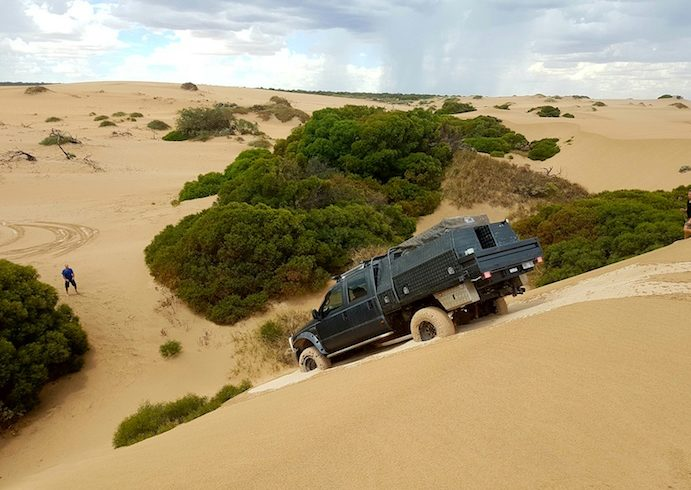 Matt takes the Effy down the high steep dune.
