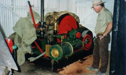 Kim inspecting engine