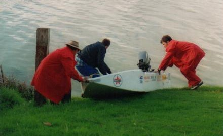 Kim, Kevin and Tony launch a boat.