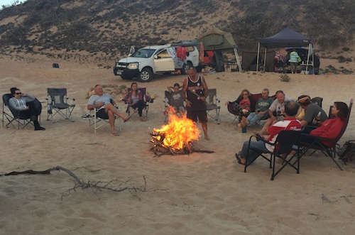 Campfire behind the dunes.