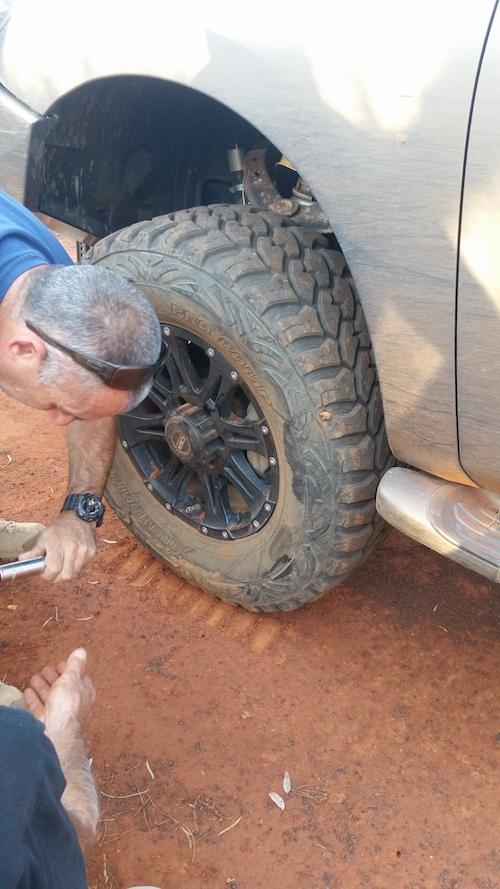 Joe putting on spare.