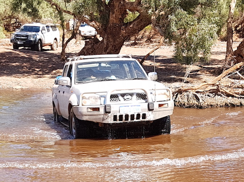 Kerry crosses the Oakover River in his Nissan Navara.