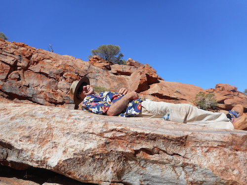 Greg relaxing above the petroglyphs.