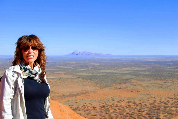 At the top of Uluru with Kata Tjuta in the background.