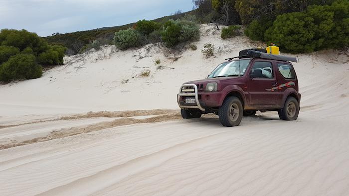 Adi up onto dunes.