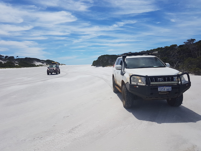 On the beach at the mouth of the Saint Mary River, Point Charles Bay, Fitzgerald River National Park. The sand bar on which the vehicles are parked is blocking the river from emptying into the ocean.