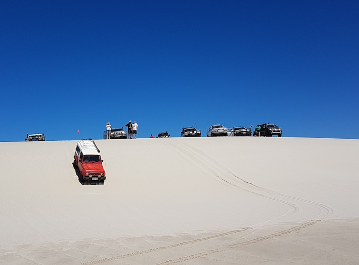 Cliff takes his Maruti down the dune.