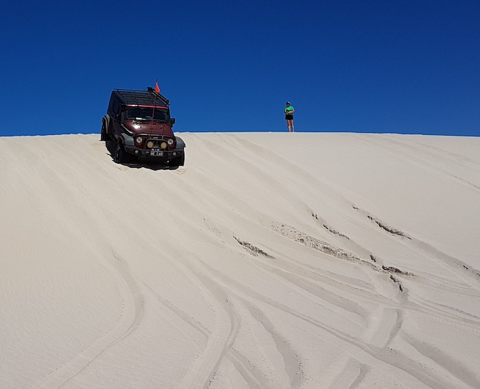 Nick takes his Jeep down the dune.