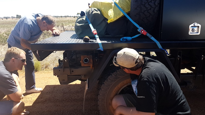 Andrew, Kerry and Matt watch as the fuel line is reverse flushed.
