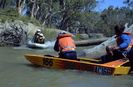 John and Stephen jump a log on the Mullaroo Creek.