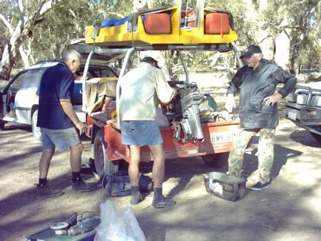 Motor repairs at Mulcra Island camp.