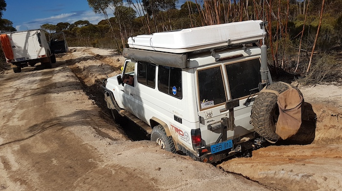 Troopy in deep gutter ready to be retrieved by Patrol.