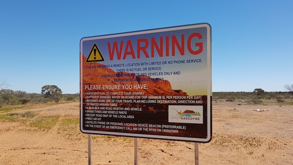 The 'no nonsense' warning sign at Mt Sandiman station. The target audience here is those attempting to cross the Kennedy Range but the warnings and recommendations apply equally well to the Moogooree Track.