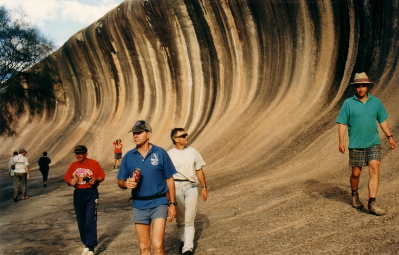 Playing tourists at Wave Rock.