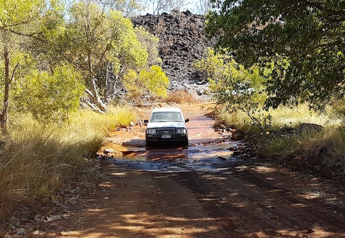 Sandy drives her Explorer through the Lennard River.