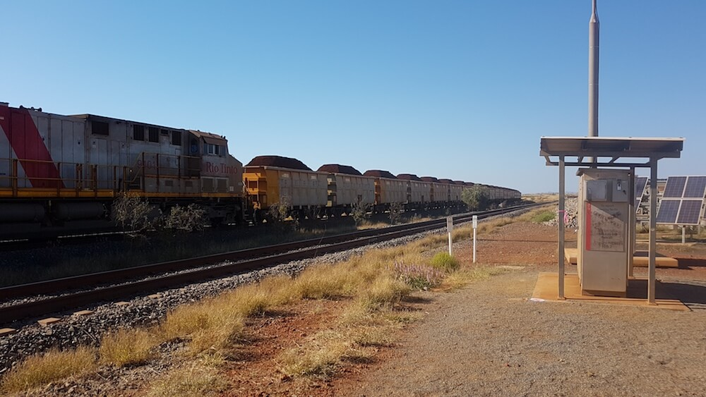 Iron ore train from Yandicoogina at Pannawonica Road Rail Crossing.