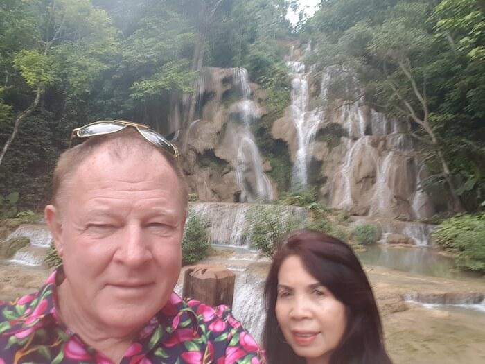 Kim and Tassy in front of the beautiful Kuang Si Waterfall.