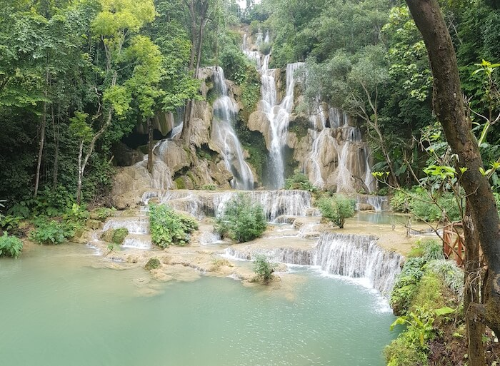 Kuang Si Falls gently cascades 50 metres over four stepped pools.