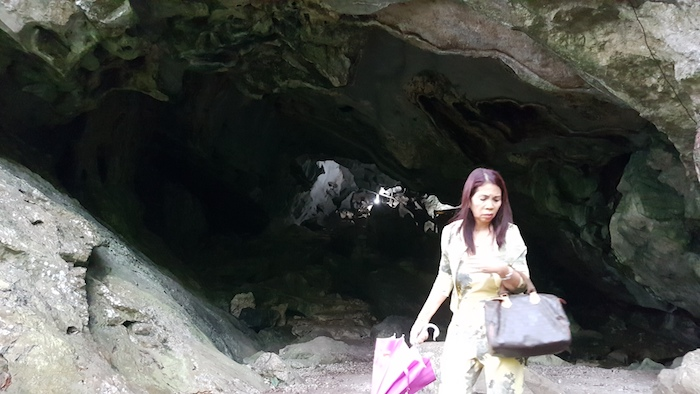 Tassy is not sure about entering the cave.