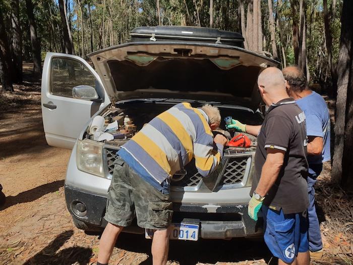 Cliff, Tony and Kerry trying to fix Tony' starter.