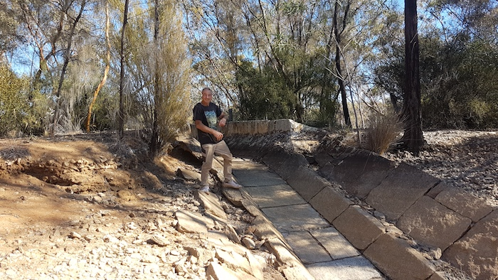 Greg at the outfall to the first dam.