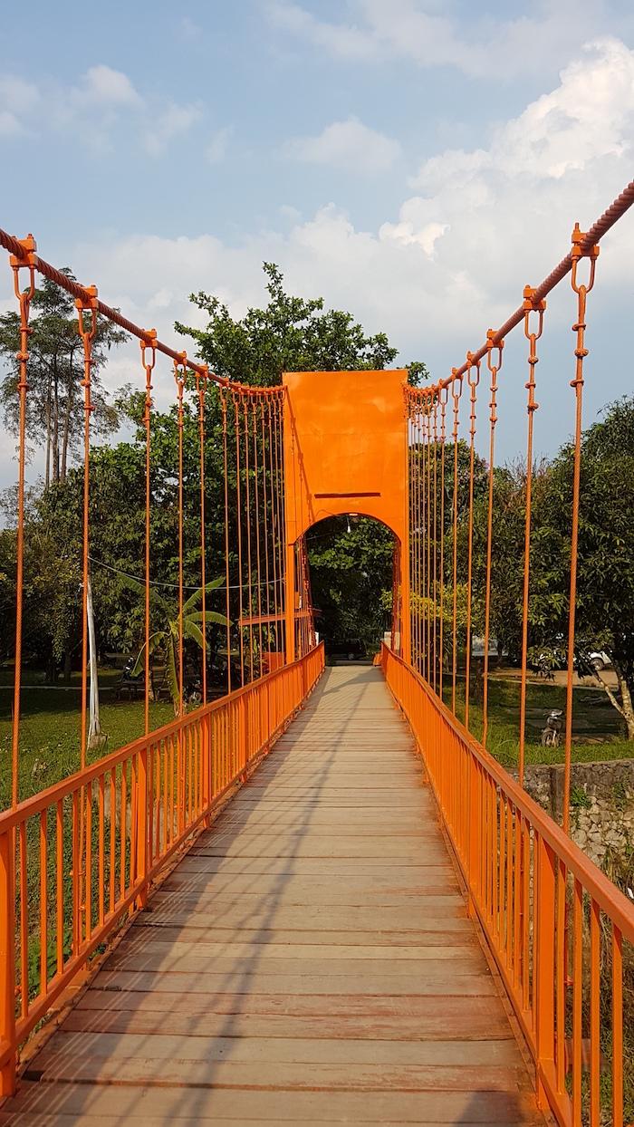 The unexceptional suspension bridge painted orange for effect.