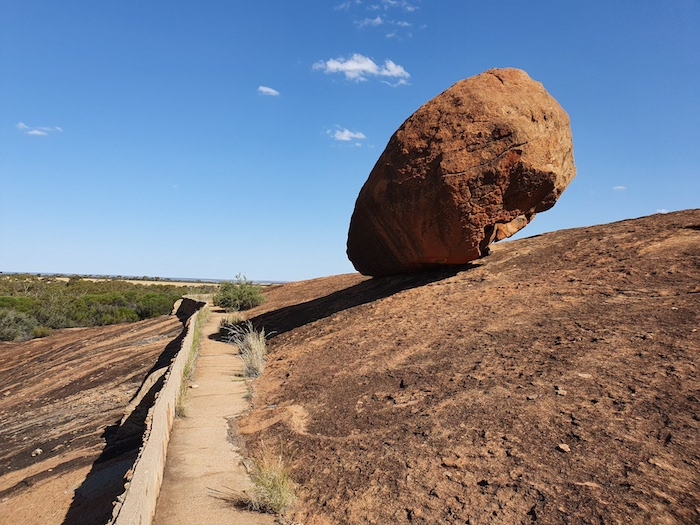 A balancing rock just above a harvest wall.