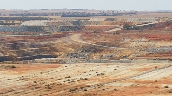 Discovered in the 1940s, major mining started in 1948. Western Mining Corporation acquired the mine in the 1970s and commenced open cut mining in 1989. Imerys Talc acquired the mine in 2011.