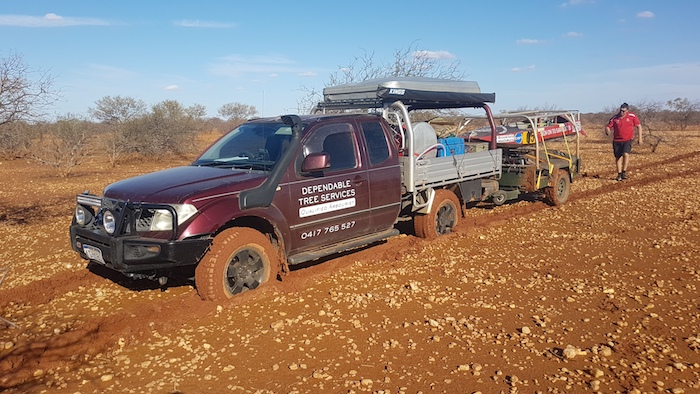 Navara and trailer bogged while seeking a path to the river.