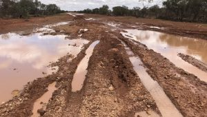 The river flowing across the road for a week caused more damage than the passage of four vehicles, despite appearances.