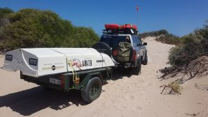 Aaron towed the trailer through the dunes to the beach.