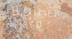 B. Dimer etched his name into the rock in 1960.