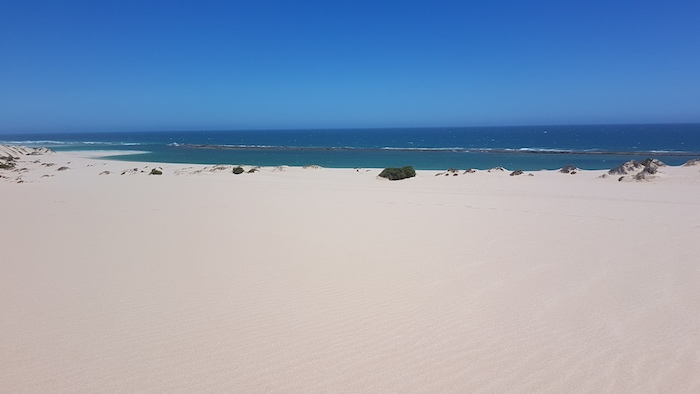 The length of the fringing reef can be seen from the top of the extensive dunes.