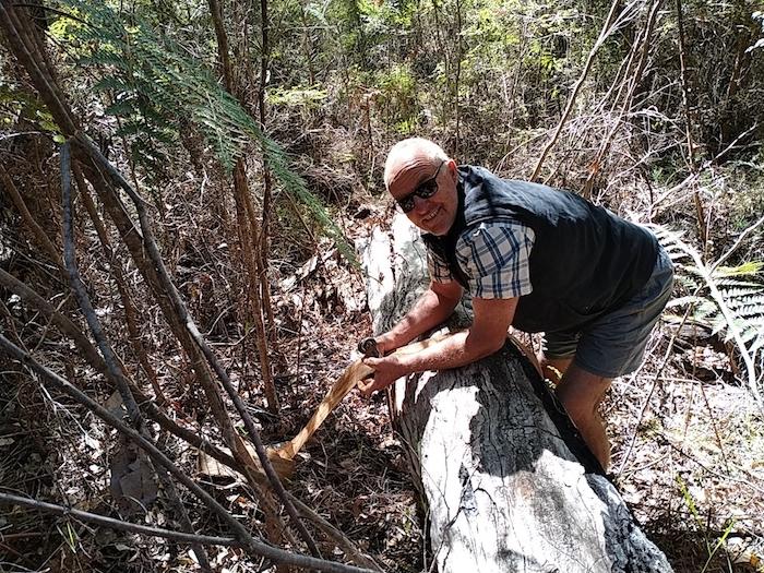Scott puts strap around log.