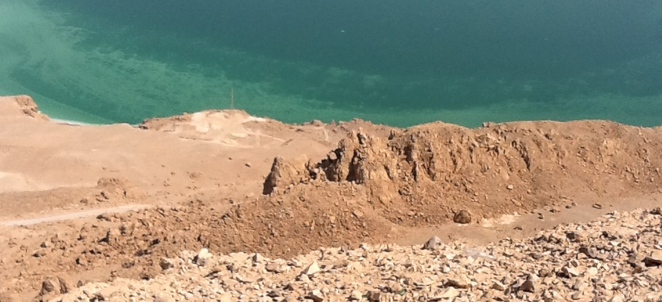 Track down the cliff to the Dead Sea.