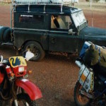Two bikes and an old Land Rover.