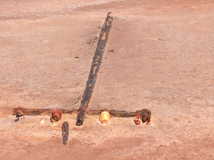Corrosion of the telegraph pole is accelerated by the salt.