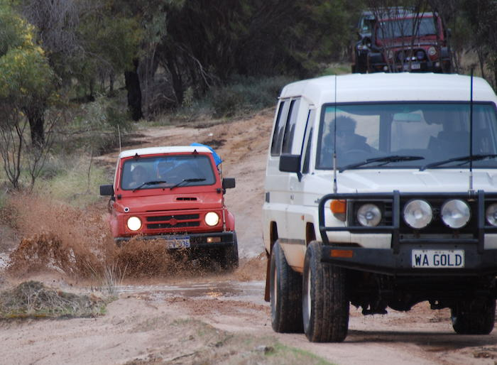 Cliff takes his Suzuki through the mud.