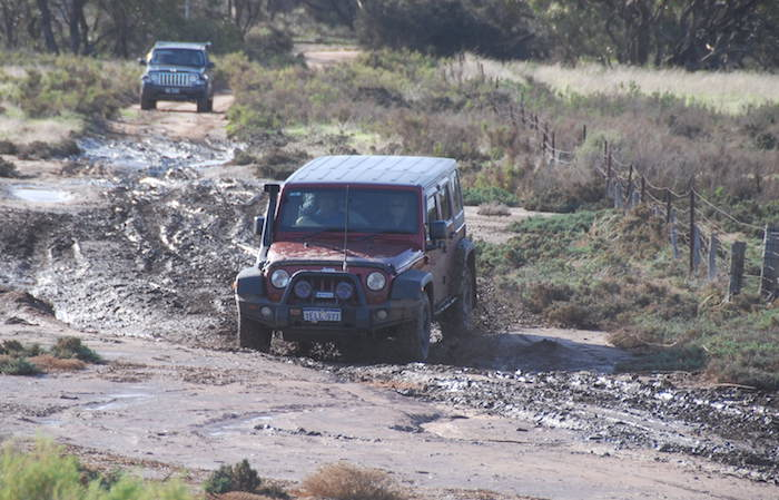 Mike takes his Jeep through the mudhole.