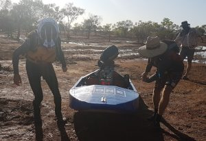 Steve and Nat dragging their boat into the water at Cadjacootharra.
